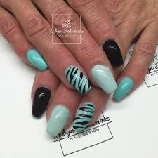 teal ombré and black coffin gel nails with hand painted zebra