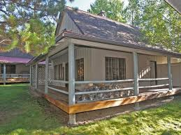 amazing small cabins with wrap around porch using grey paint