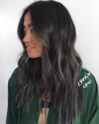 black hair with grey highlights hair and model
