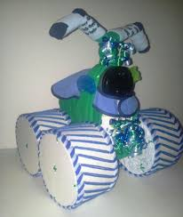 green and blue themed baby shower four wheeler diaper cake table