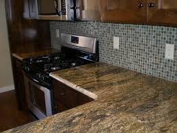 backsplash kitchen ceramic flowers white cabinets dark countertops