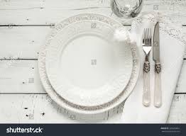 Shabby Chic Plates by White Table Setting Above Elegant Empty Stock Photo 225645664