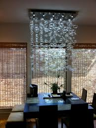 modern dining room chandeliers chandelier installation by quatro team modern dining room