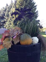 decorating for fall entrance urn and backyard half whiskey
