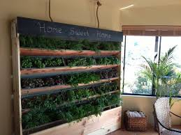 indoor vertical garden kit at its base are a container where water