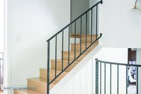 modernize stair railings by getting rid of the scrolls bigger