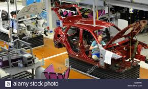 bmw car maker employees of german carmaker bmw work in the assembly line at