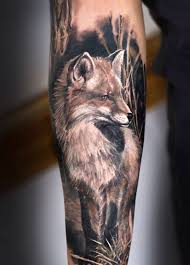 great black and white fox on arm tattoos photos
