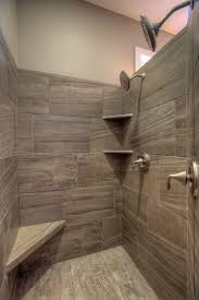 walk in tile master shower with corner seat and corner shelves 2