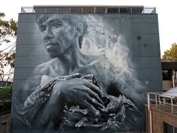 guido van helten creates a new mural in wollongong australia the wonderwalls street art festival is currently taking place on the streets of wollongong in australia
