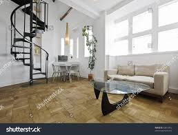 warehouse conversion apartment metal spiral staircase stock photo