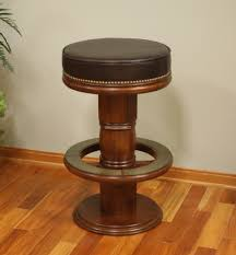round dark brown leather bar stool with brown wooden legs and foot