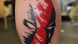 red and black ink dead pool tattoo on calf u2013 truetattoos