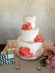 coral wedding cakes wedding cake coral roses white paisley wedding cake with coral
