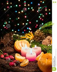 christmas candles and ornaments tangerines nuts on sackcloth with