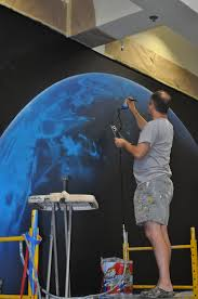 about mbr murals by renick final touches are added to earth using an airbrush by muralist tom renick