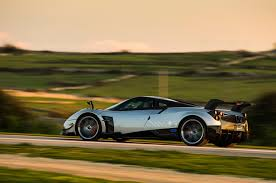 pagani dealership pagani huayra three cars wallpaper 4k ultra hd wallpaper