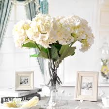 charming wedding table decoration with various white flower