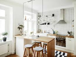 kitchen with island and breakfast bar kitchen islands breakfast bar stainless steel utensil hanging wooden