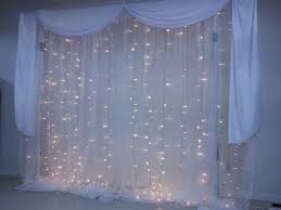 wedding backdrop fairy lights led fairy light wedding backdrops with shimmer drapes at partyzone