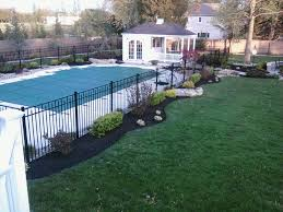 Landscaping Around A Pool by Refreshing A Swimming Pool Landscape All About The House