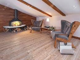 attic area comfortable seating area of the two chairs by the fireplace in