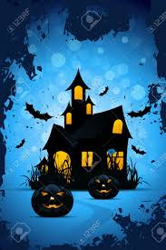halloween background with bats pumpkins and haunted house royalty