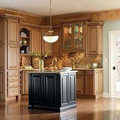 maple cabinets with black island thomasville cabinetry