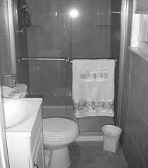 delightful bathroom with colorful tiles and small bathtub amidug