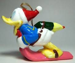 wonderful winterland donald duck on skis with rocket ornament from