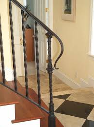 antique black wrought iron stair railing with solid brown wood