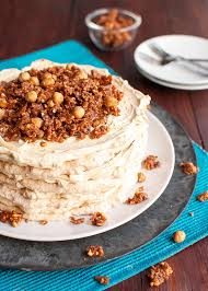hazelnut meringue layer cake with french coffee buttercream and