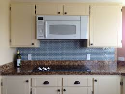 glass subway tile kitchen backsplash laminated dark floor glossy