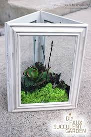 Picture Frame Centerpieces by Turn Dollar Store Frames Into Affordably Chic Terrariums