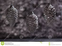 silver pine cone ornaments with bokeh stock photo image 62978472