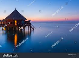 overwater bungalows on tropical island resort stock photo