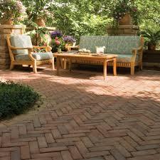 exterior appealing patio design with cozy unilock pavers