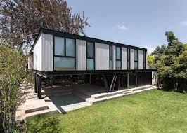 House Patio by Gregorio Brugnoli Errázuriz Raises House Above Patio And Tree