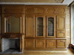louis xv style paneled room with its fireplace made out of carved