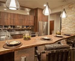 small dark brown wooden kitchen island counter light brown stone