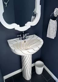 bathroom ideas decorated bathroom blog swirling gold lines sink in a navy blue powder room