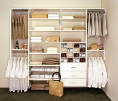 classic white wooden closet organizer with open shelves and