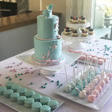aqua and pastel pink macarons cake pops and fondant cake under