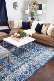 50 best rugs images on pinterest living room ideas apartment a colorful area rug is grounded by neutral furniture and a mix of metallic accessories to
