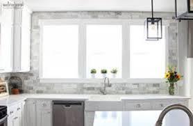 white marble backsplash tile sleek white wooden kitchen set sleek