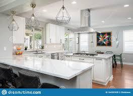 white shaker kitchen cabinets wood floors modern kitchen with white shaker cabinets editorial stock