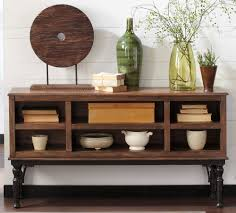 placing decorative accessories on a rustic console table house