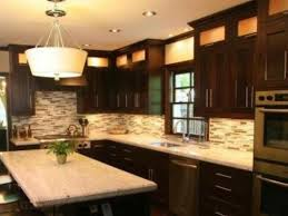contrast brown kitchen cabinets with white granite countertops jpg