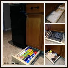 reclaim unused space below your kitchen cabinets with under