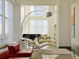 see the bright interior of a trump world tower apartment bright